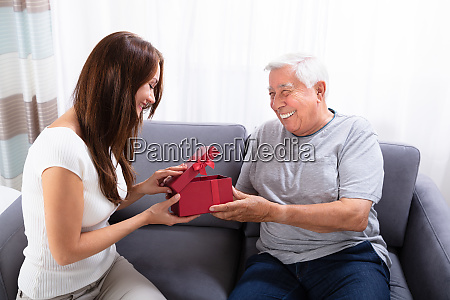 woman giving gift to her happy