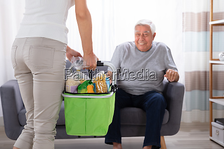 woman holding groceries in basket