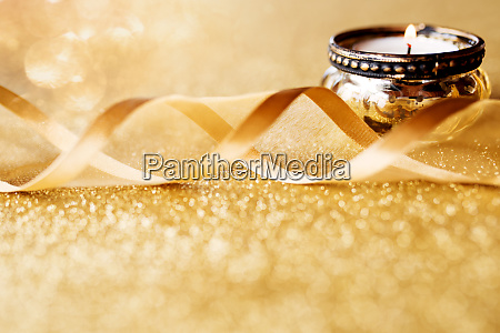 candle light on gold sparkling background