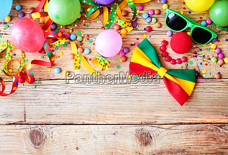 border of colorful party accessories
