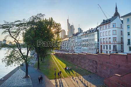 people relaxing city embankment frankfurt