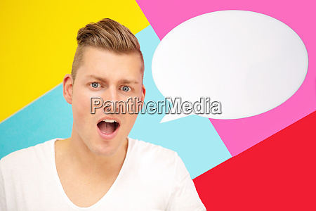 blond man holding a speech bubble
