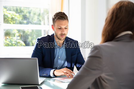 businessman looking at job candidate