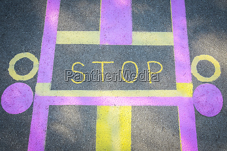 stop sign painted on road