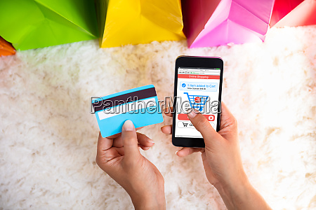 woman shopping online on mobile phone