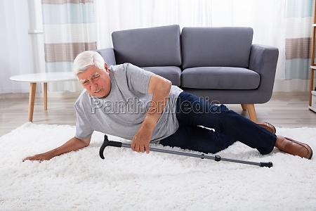 senior man fallen on carpet