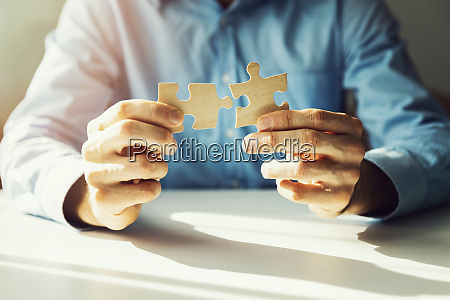 business solutions businessman connecting jigsaw