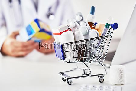mini shopping cart full of medicines