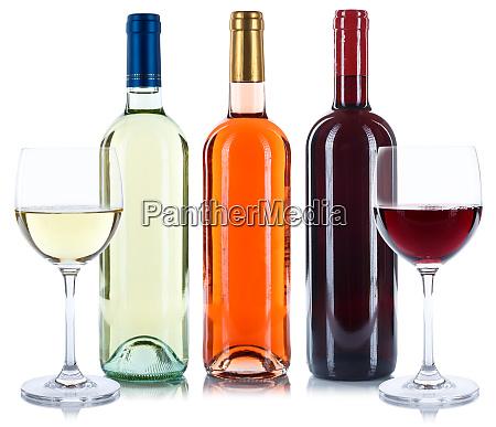 rote und weisse rosenweinflaschen getraenkebrillen isoliert