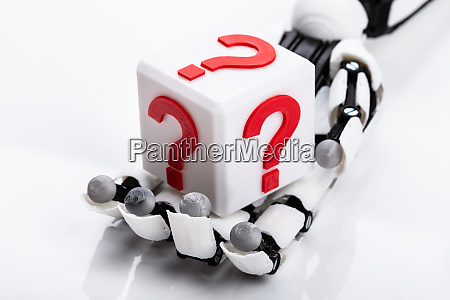 robot holding cubic block with question
