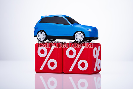 blue car over cubic blocks with