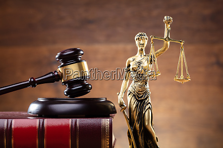lady justice near gavel over law