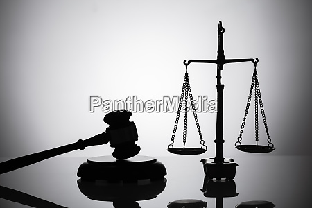 silhouette of gavel and justice scale