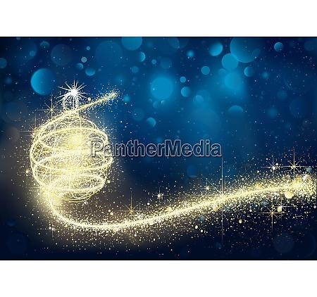 goldene weihnachtskugel in blauer bokeh nacht
