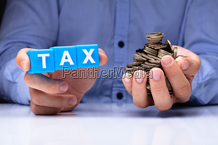 person holding tax cubic blocks and