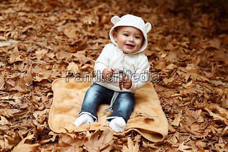 happy kid in autumn park