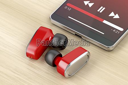rote kopfhoerer und smartphone