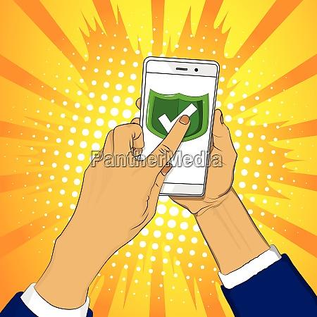 hand haelt smartphone mit gruenem schild