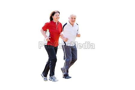 senior couple jogging on white background