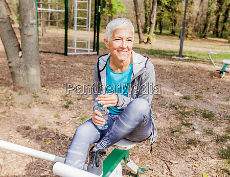 senior woman relax at outdoor fitness