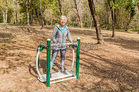 elderly woman in sports clothes exercising