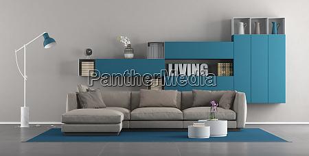 modernes wohnzimmer mit sofa und buecherschrank