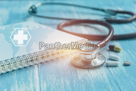 medical stethoscope with pharmaceutical medicine pills