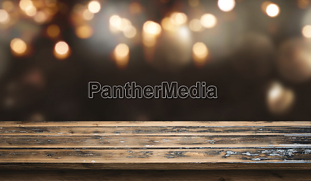 bokeh background with old wooden table