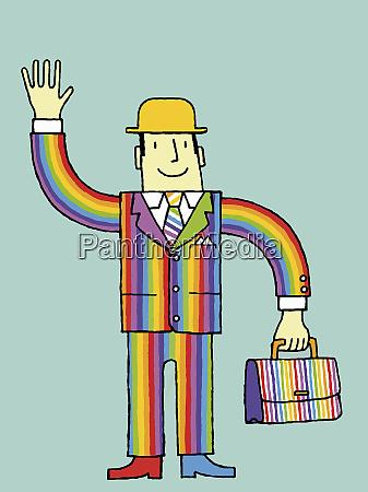 geschaeftsmann im regenbogenanzug winkt