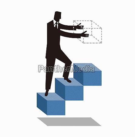 geschaeftsmann geht auf treppenbau naechsten schritt