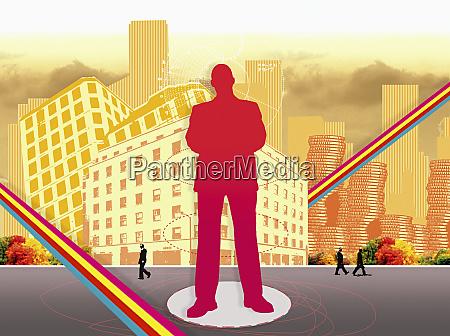 businessman standing in urban street