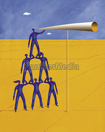 man standing on shoulders of colleagues