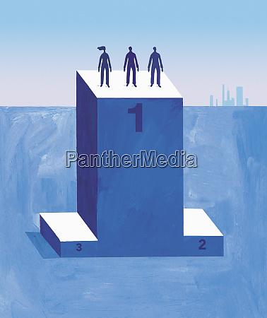silhouette of three people on winners