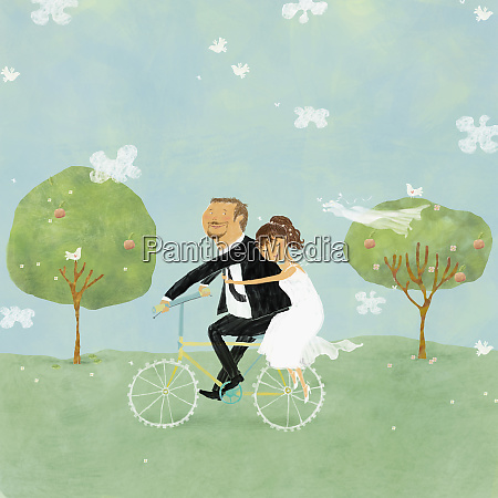 bride and groom on bicycle in
