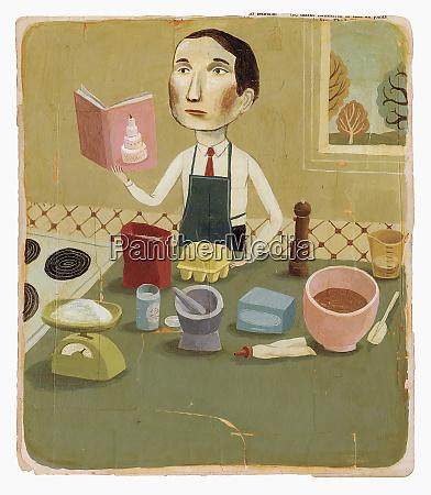 mann mit kochbuch in der kueche