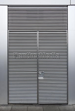 closed metallic grey door with ripples