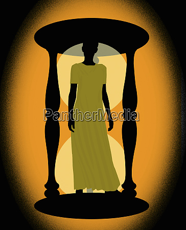 woman standing inside hourglass