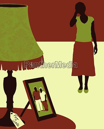 sad woman looking at photograph of