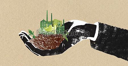 mann haelt gruene fabriken in gewuerfelter