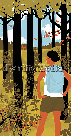woman with backpack hiking in woods