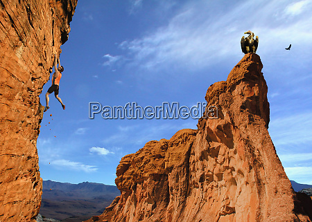 rock climber dangling from cliff wall