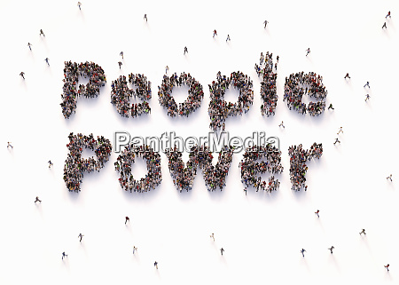 overhead view of people forming words