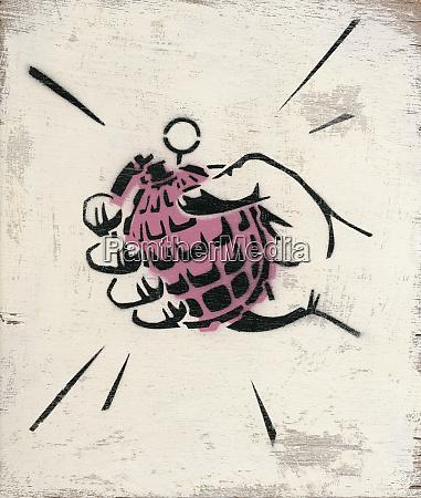 hand holding hand grenade