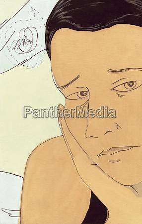 sad woman thinking of embryo
