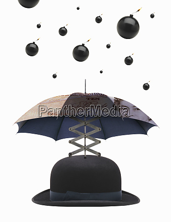 bombs dropping on umbrella bowler hat