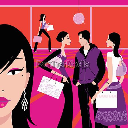 women in mall carrying shopping bags