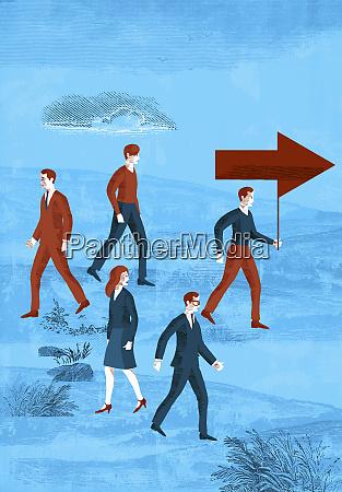 business people walking in same or