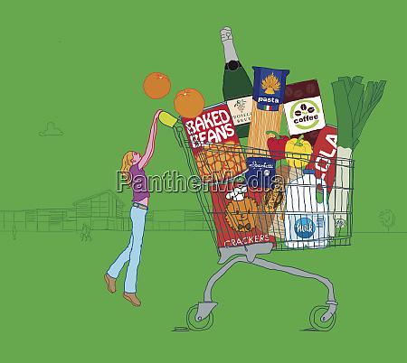 woman struggling to push huge shopping