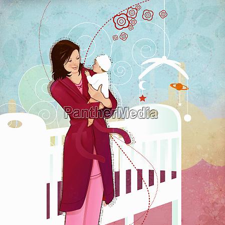 woman holding baby in nursery