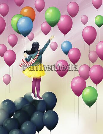 girl on black balloons reaching for
